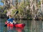 View larger image of Man kayaking at ROCK CRUSHER CANYON RV RESORT image #1