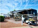 View larger image of RV parked at campsite at VAL VISTA VILLAGE RV RESORT image #12