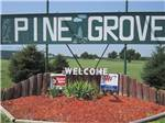 View larger image of Welcome sign at entrance at PINE GROVE RV PARK image #1