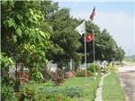 View larger image of Flagpoles at entrance at PINE GROVE RV PARK image #6