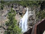 View larger image of View of a waterfall from a bridge at RIVER REFLECTIONS RV PARK  CAMPGROUND image #4