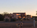 View larger image of Building at sunset at TOMBSTONE TERRITORIES RV RESORT image #4