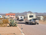 View larger image of RVs heading into campgrounds at TOMBSTONE TERRITORIES RV RESORT image #9