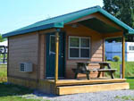 View larger image of Cabin with picnic table at NET CAMPING RESORT image #5