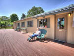 View larger image of Man sitting on the office porch at DEXTER SHORES RV PARK image #3