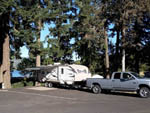 View larger image of Truck and trailer in a paved site at DEXTER SHORES RV PARK image #4