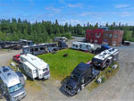 View larger image of Aerial view of grassy area surrounded by RVs at DIAMOND M RANCH RESORT image #9