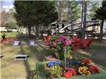 View larger image of RV parked in site with cornhole game and seating area at LAKE CITY RV RESORT image #4