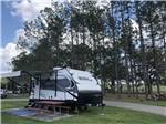 View larger image of Small trailer parked at site at LAKE CITY RV RESORT image #8