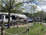 View larger image of Large trailer with grassy area at LAKE CITY RV RESORT image #10