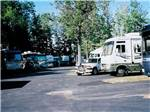 View larger image of RVs camping on asphalt and dirt at AA ROYAL MOTEL  CAMPGROUND image #4