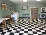 View larger image of A clean laundry room with a checkered board floor  at THE GREAT OUTDOORS RV RESORT image #8