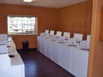 View larger image of Laundry room with washer and dryers at TWELVE OAKS RV PARK image #4