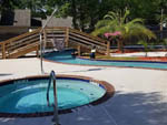 View larger image of Pool and hot tub at TWELVE OAKS RV PARK image #7