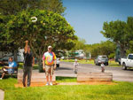 View larger image of Men playing horseshoes at LAZYDAYS RV RESORT image #11