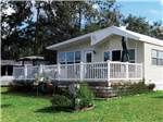 View larger image of Cabin with deck at RED OAKS RV RESORT image #3