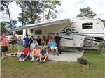 View larger image of Campers sitting at table at WEKIVA FALLS RV RESORT image #7