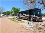 View larger image of Row of big rigs in gravel sites at FREDERICKSBURG RV PARK image #3