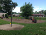 View larger image of Playground with swing set at COUNTRY OAKS CAMPGROUND image #4