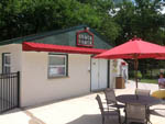 View larger image of Patio area with picnic table at COUNTRY OAKS CAMPGROUND image #5