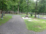 View larger image of Picnic table at campsite at COUNTRY OAKS CAMPGROUND image #6