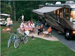 View larger image of Family camping in RV at GREYS POINT CAMP image #9