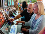 View larger image of Couple playing the slots at LITTLE RIVER CASINO RESORT RV PARK image #11