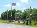 View larger image of Flagpole at entrance of RV park at RUTLADER OUTPOST RV PARK image #7