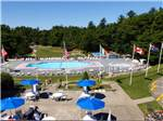 View larger image of View of park with pool and spa area at CAPE COD CAMPRESORT  CABINS image #6