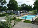 View larger image of Swimming pool with RVs in background at RIVERSIDE RV RESORT  CAMPGROUND image #5