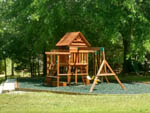 View larger image of Playground with swing set at MAGNOLIA RV PARK  CAMPGROUND image #6