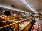 View larger image of Interior of trading post with many Native American crafts and artifacts at BLUE MOUNTAIN RV AND TRADING image #4