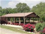 View larger image of Patio area with picnic tables at ARROWHEAD CAMPGROUND image #4