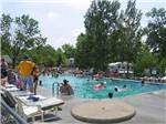 View larger image of People swimming in pool at ARROWHEAD CAMPGROUND image #6