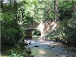 View larger image of A stone bridge that is running over a river at ECHO VALLEY CAMPGROUND image #8