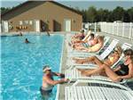 View larger image of Swimming pool with outdoor seating at SILVER CREEK RV RESORT image #1