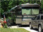 View larger image of RV parked at campsite at SILVER CREEK RV RESORT image #3