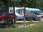 View larger image of RV parked at campsite at PUMPKIN PATCH RV RESORT image #5