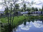 View larger image of Trailers camping on the water at SILVER SPUR RV PARK image #1