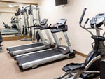 View larger image of A row of treadmills in the exercise room at COTTONWOOD INN  SUITES  RV PARK image #4