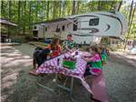 View larger image of Family camping in RV at DANFORTH BAY CAMPING  RV RESORT image #2
