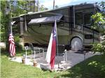 View larger image of Patio area with picnic tables at FOREST RETREAT RV PARK image #3