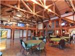 View larger image of Interior of lodge with tables and chairs at MCCALL RV RESORT image #8