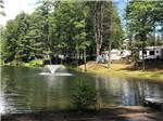View larger image of Trailers camping on the water at ADIRONDACK GATEWAY CAMPGROUND image #6