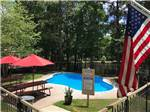 View larger image of Swimming pool at campground at LONE STAR LAKES RV PARK image #6