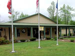 View larger image of Three flagpoles at entrance of RV park at BRUNSWICK BEACHES CAMPING RESORT image #5