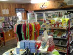 View larger image of General Store with colorful clothing drinks and food at BRUNSWICK BEACHES CAMPING RESORT image #7