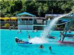 View larger image of People playing in the pool at PINE COVE BEACH CLUB  RV RESORT image #1