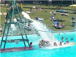 View larger image of Kids playing at waterpark at PINE COVE BEACH CLUB  RV RESORT image #5