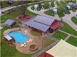 View larger image of Aerial view of playground and pool at MILL CREEK RANCH RESORT image #1